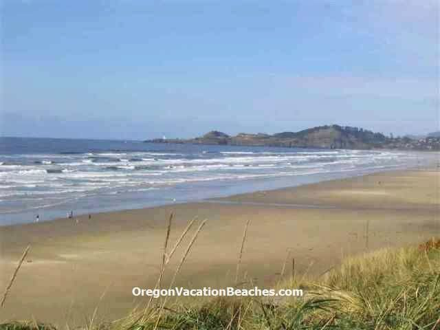 Oregon coast sandy beach + Yaquina Head Lighthouse